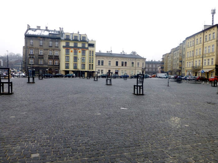 Haunting memorial of empty chairs at deportation site. Jewish Quarter.