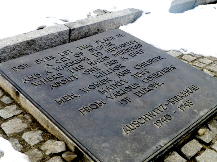 the plaque that at Dachau has been translated into 30+ languages